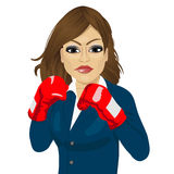 Business woman ready to fight with boxing gloves. Over white background Royalty Free Stock Image