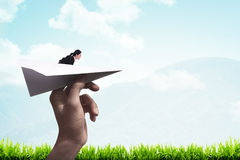 Business woman ready to launch with paper plane Royalty Free Stock Photos