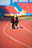 Business woman ready to sprint Stock Image