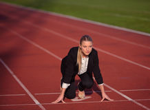 Business woman ready to sprint Royalty Free Stock Photos