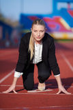 Business woman ready to sprint Royalty Free Stock Photo