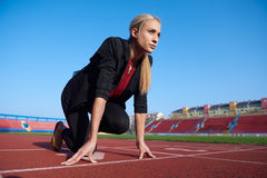 Business woman ready to sprint Stock Images