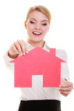 Business woman real estate agent holding red paper house Stock Photo