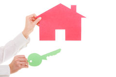Business woman real estate agent holding red paper house key Stock Photography