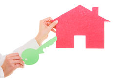 Business woman real estate agent holding red paper house key Stock Image