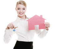 Business woman real estate agent holding red paper house keys Stock Photos