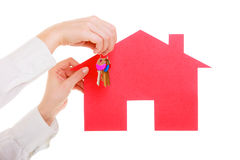 Business woman real estate agent holding red paper house keys Royalty Free Stock Image