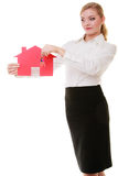 Business woman real estate agent holding red paper house keys Stock Images