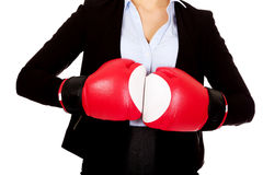 Business woman in red boxing gloves Stock Photo