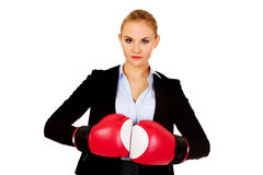 Business woman in red boxing gloves stock image