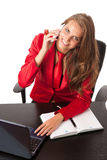 Business woman in red dress working on alptop Stock Photos