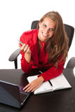 Business woman in red dress working on alptop Royalty Free Stock Photos