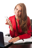 Business woman in red dress working on alptop Royalty Free Stock Image