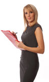 Business woman with red folder. Business woman smiling and writing on red folder Stock Images