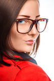 Business woman in red jacket and glasses Stock Photography