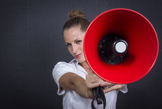 Business woman with red megaphone Royalty Free Stock Images