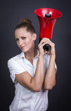 Business woman with red megaphone Royalty Free Stock Photo