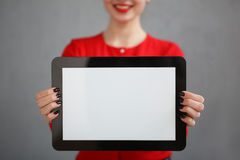 Business woman with a red shirt and glasses portrait, holding a tablet in his hands Stock Photography