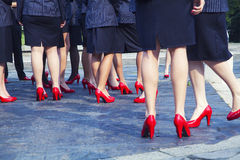 Business woman in red shoes outdoors. Detail Stock Image