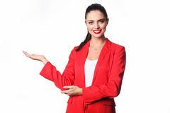 Young business woman is presenting something. Royalty Free Stock Photos