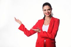 Young business woman is presenting something. Stock Photo
