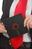 Business woman red tie holding floppy Stock Photos