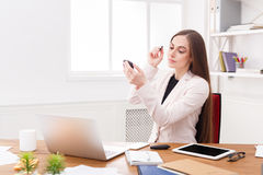 Business woman refreshing her makeup at office Royalty Free Stock Photo