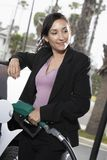 Business Woman Refueling Her Car Royalty Free Stock Images
