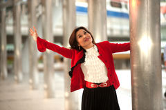 Business woman rejoice with arms outstretched . Royalty Free Stock Photography