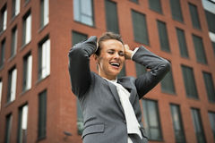 Business woman rejoicing in front of office Royalty Free Stock Images