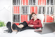 Business woman relax with legs on the table Stock Photography