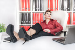 Business woman relax with legs on the table Stock Photo