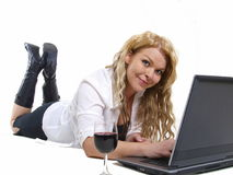 Business woman relaxing. With a glass of wine Stock Photography