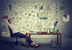 Free Business Woman Relaxing At Her Desk In Her Office Royalty Free Stock Image - 58228276