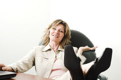 Business woman relaxing in board room Stock Photo