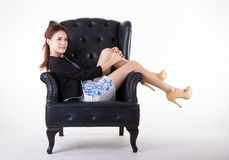 Business woman relaxing in a chair stock image