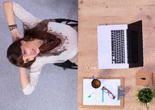 Business woman relaxing with  hands behind her Royalty Free Stock Photography