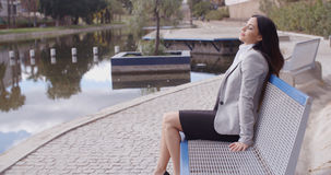 Business woman relaxing near canal Stock Photography