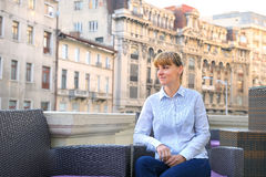 Business woman relaxing on the terrace. Royalty Free Stock Photography