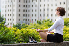 Business woman relaxing with yoga in the city Stock Photography