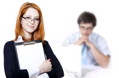 Business woman with a represent folder. Portrait of the business woman with a represent folder and boss at background stock photo