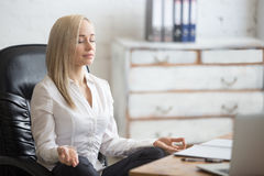 Business woman resting in yoga pose Royalty Free Stock Photos
