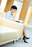Business woman rests at the sofa Royalty Free Stock Photo
