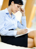 Business woman rests at the sofa Stock Images