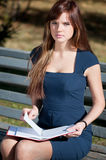 Business woman reviewing diary at city park Royalty Free Stock Image