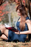 Business woman reviewing diary at city park Royalty Free Stock Photography