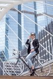 Business woman riding bicycle to work on urban street in city .transport and healthy . fashion lifestyle cool smart. Portrait sunglasses model female girl royalty free stock photography
