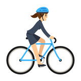Business woman riding a bicycle Royalty Free Stock Images