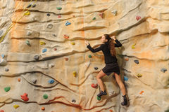 Business woman on rock wall Royalty Free Stock Photos