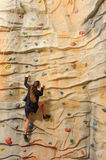 Business woman on rock wall Stock Photos